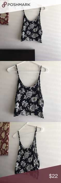 Brandy Melville Floral Crop Top Authentic. One size fits most. Worn maybe twice. Still in excellent shape. Send offer or bundle to save. Flowers are an off white/slightly cream color. Brandy Melville Tops Crop Tops