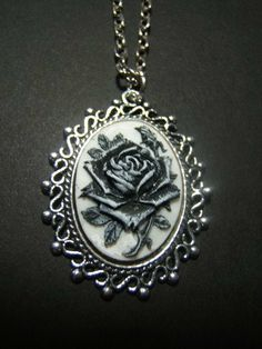 Hey, I found this really awesome Etsy listing at https://www.etsy.com/listing/179715641/gothic-black-rose-goth-cameo-necklace