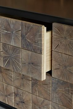Detail from Instomi metal sideboard by Meyer von Wielligh showing end grain of an oak log used to face drawers. Also fingerjointing.