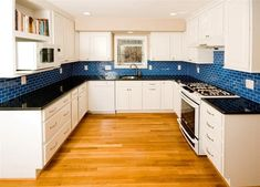 White Kitchen Cabinets and Blue Subway Tile Backsplash - Modern Blue Tile Backsplash Kitchen, Blue Kitchen Cabinets, Subway Tile Kitchen, Kitchen Redo, Kitchen Remodel, White Cabinets, Teal Kitchen, Backsplash Ideas, Kitchen Ideas