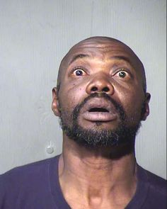 Arrested for obstructing a highway, possession of drug paraphernalia. He looks surprised.