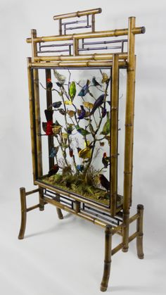 Victorian bamboo firescreen containing taxidermy tropical birds with beetles and butterflies. All of South American origin. Last quarter of the Nineteenth Century.