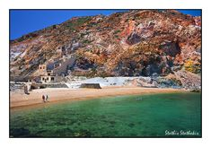Red beach - old sulphur mines. One of the most beautiful beaches on Milos Isl. Near the abandoned buildings of the mine you can still see wagons on the tracks, old rusty tools and spare parts in the storage room. A small trip in 1960 when Milos Sulphur Mines ceased to operate.