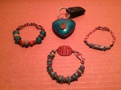 """In my package was the faux stone pendant, thin Roman glass disks, recycled African glass beads, wooden spacers, and copper spacers. I added the charm to the center of the pendant the says """"Well behaved women rarely make history"""" and went with an ancient history theme."""
