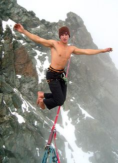 Michael Kemeter  - August 12, 2011  Austrian Michael Kemeter walks across the highest taut slackline at 3770 meters altitude, battling blowing wind and snow.
