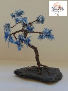 A personal favourite from my Etsy shop https://www.etsy.com/uk/listing/540880166/blue-coral-wire-wrapped-tree-sculpture