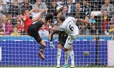 Robin van Persie scores the opening goal for Manchester United at Swansea in the Premier League at the Liberty Stadium