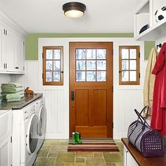 Laundry, mud room,  and places to hang coats all in one room.  Plus countertop space to do just about anything. Love it!