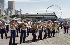 Marines with the 3rd Marine Aircraft Wing Band give a performance in Seattle, July 30, as a part of Marine Week Seattle 2014. Marine Week Seattle showcases Marine Corps equipment, aircraft and technological capabilities to the general public. More than 700 Marines are participating in Marine Week Seattle to give Seattleites the opportunity to meet the individual Marine and celebrate community, country and Corps. #USMC photo by Cpl. Brandon Suhr #MWSEA14 #MarinesTakeSeattle