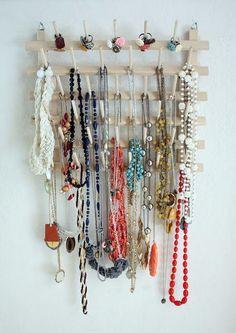 DIY Jewelry Organizer - it's a thread organizer from JoAnn's. So clever. :)