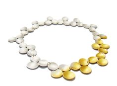 Extravagant gold and silver disc #necklace by British designer Kokkino.   Emerging Designer Jewellery Boutique // London based // Free Shipping // Songofjewellery.com