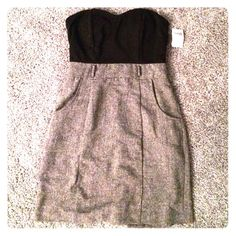 Sweetheart neck strapless mini dress. Strapless, zips at the back, 2 front pockets. From Charlotte Russe, size small. With tags never worn. Black on the top and heather gray on the bottom. Charlotte Russe Dresses Mini