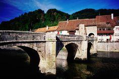 St-Ursanne, Jura , Switzerland Bridge over River Doubs. Amazing Places, Wonderful Places, Zermatt, Lonely Planet, Brooklyn Bridge, Homeland, Bridges, Switzerland, Places To See