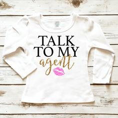 Talk To My Agent Toddler Girl Sparkle Shirt in Glitter Gold and Glitter Pink. Browse the entire collection at www.shopcassidyscloset.com