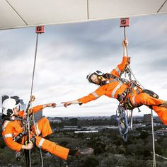 This is one of our favourite shots - does it look familiar at all? #Michelangelo #creation #creationofAdam #RopeAccess #sistinechapel @petzl_official @msasafety with the best background going around #Melbourne