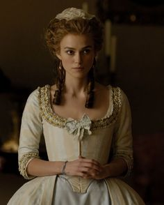 The Duchess - I love the trim on this dress, especially the bow, and I love the colors... I might need to make one! :)