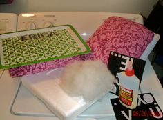 NO SEW DIY LAP DESK Materials: basic tray from any dollar store,  thick piece of Styrofoam cut to size, an old pillowcase, stuffing, straight pins, and industrial glue.  Instructions: Take your Styrofoam, place it face down, put stuffing on top, then wrap the Styrofoam with an old pillow case .  Stick pin the pillow case firmly into place.  Then put industrial glue on the back of the tray and glue the Styrofoam board to the bottom of the tray.  Allow to dry overnight and decorate desk.