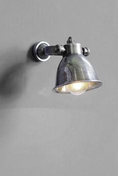 The Chehoma Adjustable Small Dome Antique Silver Spotlight Wall Light is well designed and a great simple yet stylish spotlight option. Often seen in cafes, restaurants and kitchens - these spot wall lights are the perfect mix of industrial and classic styles. The harsh metal is softened by the curve of the domed shade. The small backplate means this light is ideal for mounting on book cases or shelves where the mounting area is small.