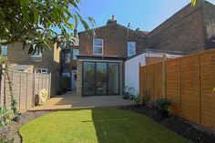 Bi-fold doors on a London Victorian terraced house kitchen extension