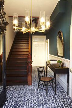 Rejuvenation Kiku chandelier adds Mod appeal to a traditional hall.