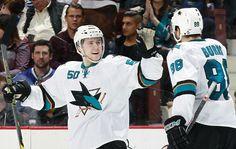 San Jose Sharks forward Chris Tierney celebrates his first career NHL goal with defenseman Brent Burns (Feb. 5, 2015).