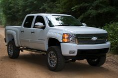 Chevy Silverado I am lost dont know If I want a new truckkkkkk ...I reallly love the look of the lift kit . It messes with the tow cap.