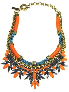 Statement jewelry in bold highlighter hues elevates otherwise simple outfits to new levels of summertime chic. Auden necklace, $678, audendesign.com.   - HarpersBAZAAR.com
