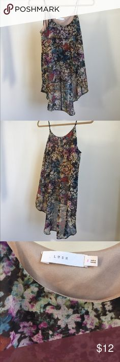 High low floral top A pretty, flowy high low top with floral print. The outer material is sheer but there is a lining for modesty, and is cute and lightweight for summer. Nordstrom Tops Camisoles