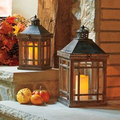 Enliven your surroundings with this warm display. Made of wood and metal with glass windows, the Hanover Lantern Set unhinges at the top so you can easily add a faux candle.