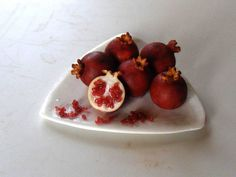 pomegranates by the amazing Erzsébet Bodzás of Hungarian Miniatures- did you know she's on Pinterest?