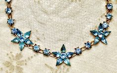 """Vintage Unsigned Beauty Blue Star Rhinestone Necklace is a wonderful sweet older necklace with a trio of stars with teardrop prong set """"stones"""" open work chain set with  prong set chatons and estimate"""