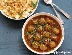 Vegetable Manchurian - Vegetable meatballs simmered in a spicy and tangy soya-ginger-garlic based sauce served over fried rice or noodles