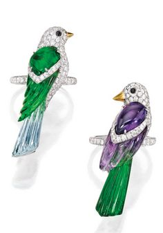 PAIR OF 18 KARAT WHITE GOLD, COLORED STONE, DIAMOND AND ONYX RINGS, MICHELE DELLA VALLE Designed as pair of parrots, one composed of amethyst and tourmaline, the other composed of blue topaz and green glass, accented by round diamonds weighing a total of approximately 3.55 carats, completed by round onyx eyes, both rings size 6½, signed Michele della Valle, numbered 140731 and 140732. With signed box.