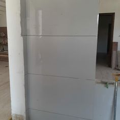 Some tiles work in house. Wall tile work in dressing room and outdoor wall tiles. Vitrified Tiles, House Map, Outdoor Walls, Dressing Room, Wall Tiles, House Plans, Construction, Flooring, Interior