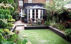 low, dark grey raised bed.  London garden