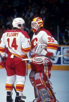 Goalie Jeff Reese and Theoren Fleury of the Calgary Flames talk during an NHL game in November 1992 at the Olympic Saddledome in Calgary Alberta. Ice Hockey Teams, Hockey Goalie, Field Hockey, Hockey Players, Flames Hockey, Theoren Fleury, Flame Picture, Canada Hockey, Goalie Mask