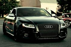 Who the hell wouldn't want this :P Audi RS5 in Black on Black on Black. OMG, sexiest car ever