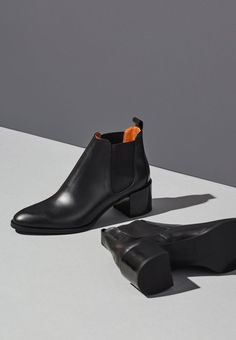 Black simple booties.  Minimalist women shoes | Minimalist footwear for her | Minimalist shoes | Capsule wardrobe | Intentional living | Slow fashion | Simple style