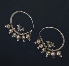 Iran | These earrings, used by the Yomud population, have a half moon shape, and at the centre of the circle there is the symbol of two peacocks that are reminiscent symbols of the ancient Sassanid. | ca. first half of the 20th century