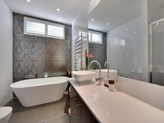 Tiled feature wall behind bath