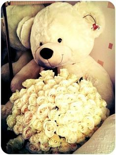 white big bear with roses