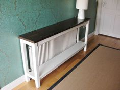 10 Cool Ways To Improve Your Home With a DIY Radiator Cover - Narrow table to cover the radiator Best Picture For Home diy bedroom For Your Taste You are looki - Diy Radiator Cover, Radiator Shelf, Radiator Ideas, Painted Radiator, Radiator Cap, Diy Deco Rangement, Kitchen Radiator, Narrow Table, Deco Design