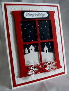 window card...red frame with snowy night scene outside...serene & lovely...