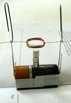 """In the """"Building a Simple Motor Puts a New Spin on Magnets"""" electricity and electronics #science project, students build a simple Beakman motor and investigate how design changes affect the rate and direction of rotation. A project kit of specialty items is available to do this science project! [Source: Science Buddies, http://www.sciencebuddies.org/science-fair-projects/project_ideas/Elec_p051.shtml?from=Pinterest] #STEM #scienceproject"""