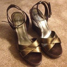 Coach Metallic Bronze Wedges Great condition! Will be a great addition to your closet. Coach Shoes Sandals