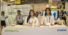 Two Models Working a Trade Show Booth