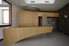 La reception presso il Red's Hotel. Divider, Reception, Cabinet, Storage, Room, Furniture, Home Decor, Clothes Stand, Purse Storage