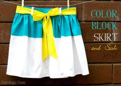 tutorial for a color-blocked skirt with a flat-front panel, a gathered back-waist and a tie in front - this is adorable and a very clear tutorial!