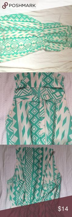 Green and White Tribal Print Dress This cute collared dress is great during the spring and summer. It's 100% polyester blend allows a cooler feel and more comfortable experience when wearing this product Event Dresses Midi