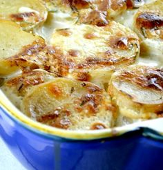 Boursin Scalloped Potatoes : Peel, thinly slice 3lbs russet potatoes. In pot, heat 1c whipping cream, 1c half n half, 5oz pkg Boursin herb/garlic cheese -crumbled. Stir til smooth. Overlap half of taters in greased 9X13dish. Generously season with s+p; pour half of liquid evenly over top. Repeat. Bake 400deg 55-65min. Garnish with 2Tbsp chopped chives.